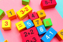 Child Kid Colorful Education Toys Cubes With Numbers Math Pattern Background On The Bright Background. Flat Lay. Childhood Infancy Children Babies Concept.