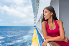 Luxury Travel Cruise Vacation Asian Elegant Lady On Holiday Ship In Caribbean Destination Getaway. Tourist Girl In Red Dress On Deck Looking At Ocean.