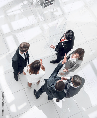 top view. employees discussing work issues