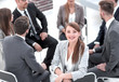 young business woman sitting in a circle of colleagues