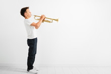 A Child Playing Trumpet On White Background