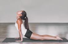 Asian Woman Stretching Lower B...