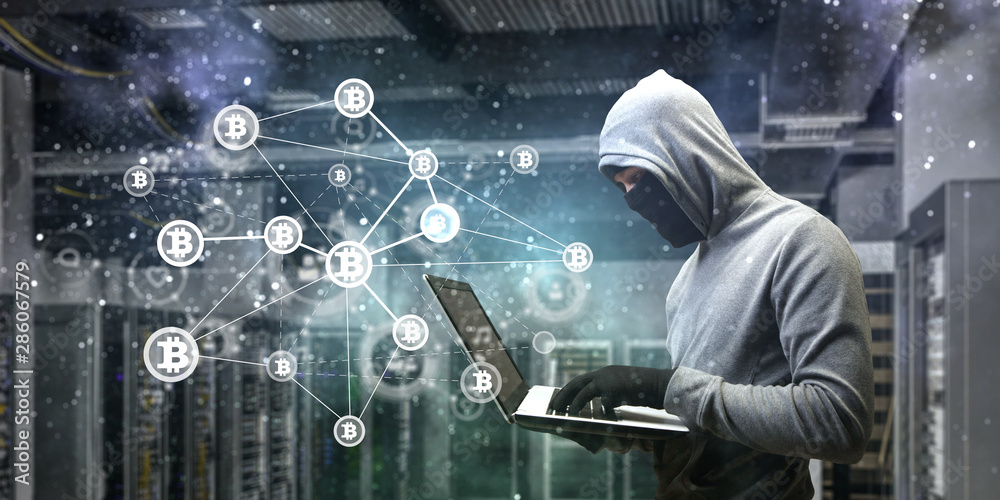 Fototapeta Hacker hunting for crypto currency