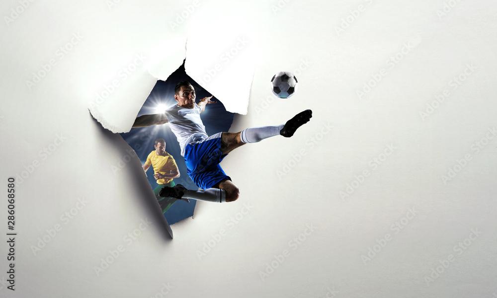 Fototapeta Paper breakthrough hole effect and soccer