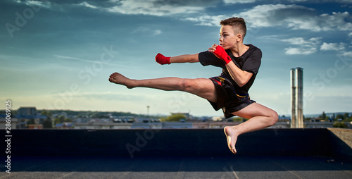 Young fighter training on the roof Canvas Print