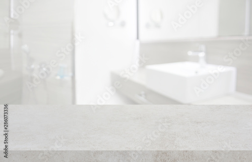 Fotomural  Stone table top and blurred hotel bathroom interior as background