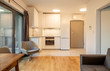 Leinwanddruck Bild - Interior of a modern micro apartment with living room and kitchenette
