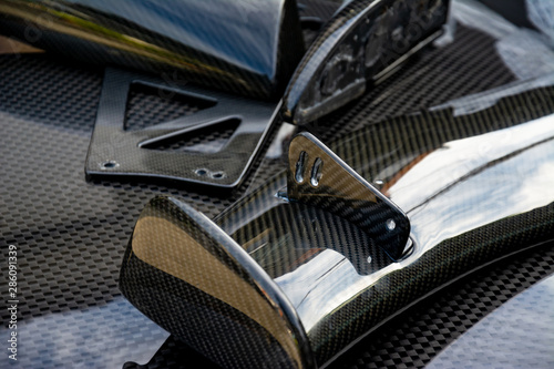 Obraz Carbon fiber composite product for motor sport and automotive racing - fototapety do salonu