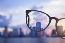 Modern Bright City View Through Eyeglasses