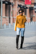 Asian girl in yellow sweater on the street in Shanghai