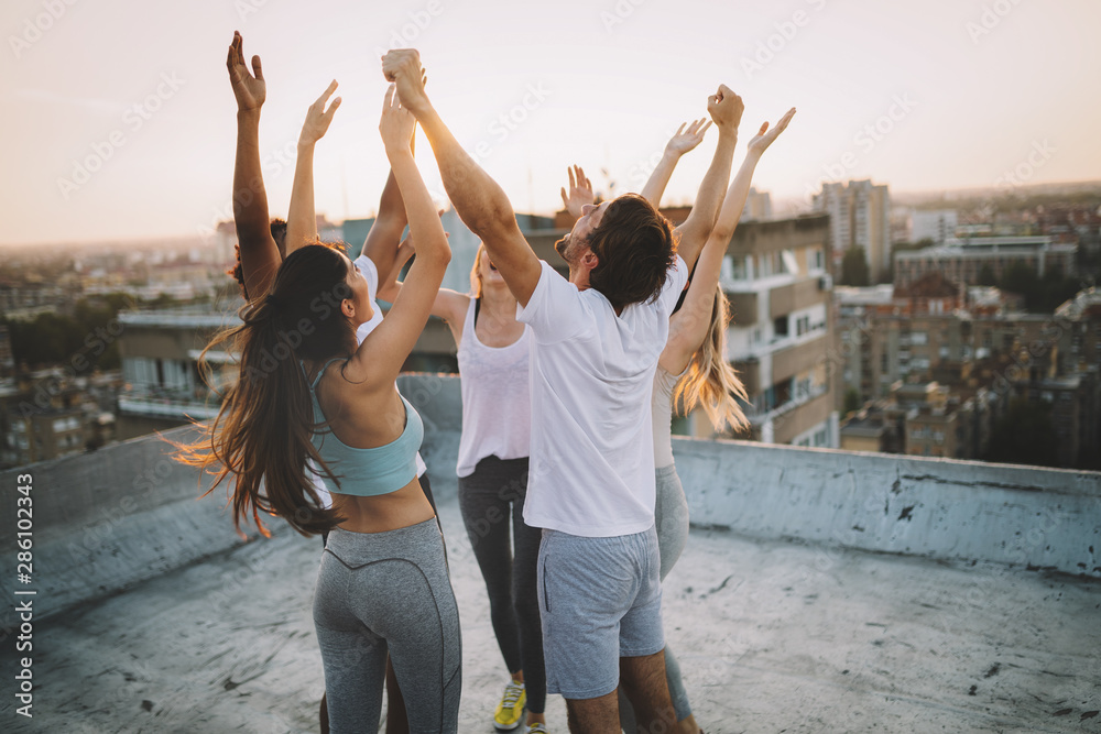 Fototapeta Fitness, sport, friendship and healthy lifestyle concept - group of happy sporty friends