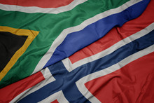 Waving Colorful Flag Of Norway And National Flag Of South Africa.