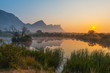 canvas print picture - Magic sunrise landscape inside the Entabeni Safari Game Reserve with the Hanglip or Hanging Lip mountain peak, Waterberg, Limpopo Province, South Africa.