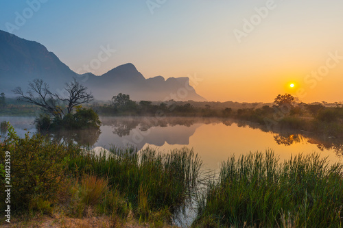 Magic sunrise landscape inside the Entabeni Safari Game Reserve with the Hanglip or Hanging Lip mountain peak, Waterberg, Limpopo Province, South Africa.