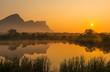 Leinwanddruck Bild - Landscape of the Hanging Lip or Hanglip mountain peak at sunrise with mist hanging above a swamp lake inside the Entabeni Safari Game Reserve, Limpopo Province, South Africa.