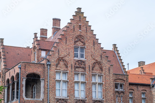 Photo  Building made up of bricks dating from the medieval times in Bruges, Belgium