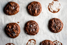 Overhead View Of Flourless Cocoa Cookies On Parchment Paper