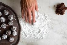 Overhead View Of Man's Hand Preparing Gingerbread Rum Balls