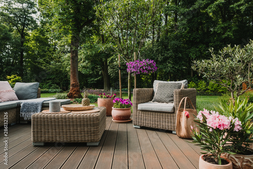 Obraz Elegant garden furniture on terrace of suburban home - fototapety do salonu