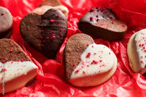 Close up of heart shaped chocolate dipped valentines cookies