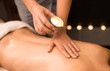 canvas print picture beauty, wellness and bodycare concept - close up of woman having back massage with hot oil candle at spa