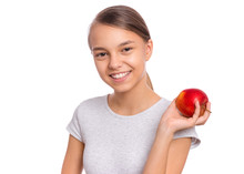 Portrait Of Beautiful Young Teen Girl Holding Fresh Red Apple, Isolated On White Background. Smiling Pretty Child With Healthy Raw Vegetables In Hands. Organic Natural Healthy Food Produce.