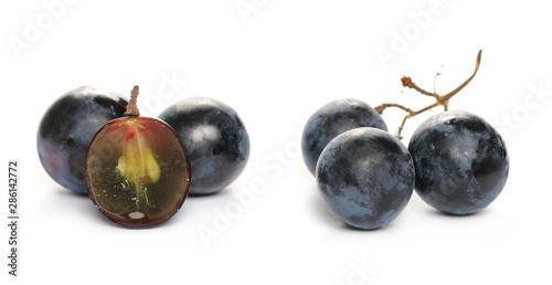 Slika na platnu Fresh dark, black half grapes isolated on white background