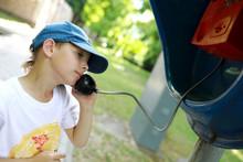 Boy Talking On Analog Phone