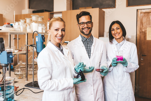 Middle age scientists and researchers work in chemical laboratory Wallpaper Mural