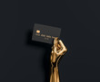 canvas print picture - Abstract Gold hand sculpture holding credit card, The best banking offer for VIP customers. 3d illustration