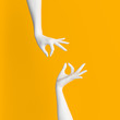 canvas print picture - Abstract Hand pose like picking something isolated on yellow. 3d illustration