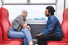 Friends Travelling By Train On Rainy Day Having Fun, London, UK
