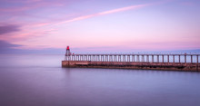 View Of Whitby Pier Against Sk...