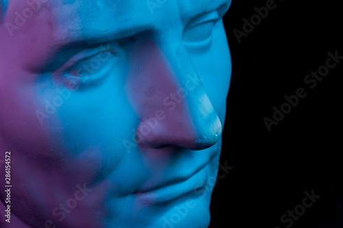 Gypsum copy of ancient statue Augustus head isolated on black background Canvas Print