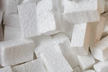 Heap Of Many Rectangular Pieces Of Styrofoam For Packing Parcels. Close-up. Background