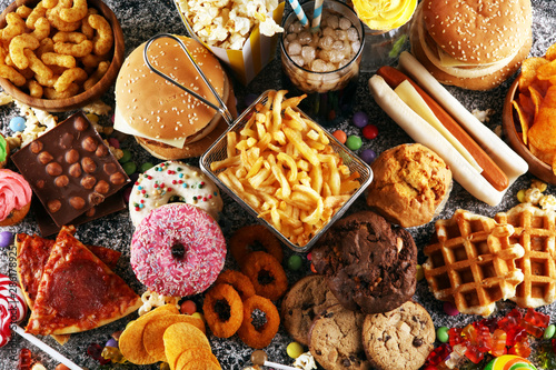 Unhealthy products. food bad for figure, skin, heart and teeth. Fotobehang