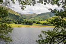 Hiking Between Brotherswater To Angle Tarn In Patterdale Part Of The English Lake District Surrounded By Many Wainwrights