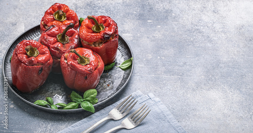Fototapeta  Stuffed red sweet peppers with meat and rice on metal tray with space for text