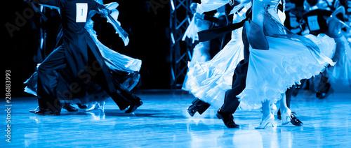 woman and man dancer latino international dancing. Blue filter Canvas Print