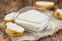 Some Fresh Bread Crumbs On Wooden Background (selective Focus; Close-up Shot)