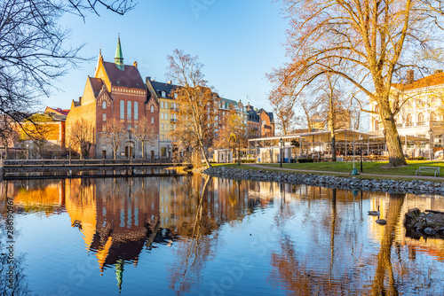 Beautiful buildings stretched alongside Svartan river in Orebro, Sweden - 286190967