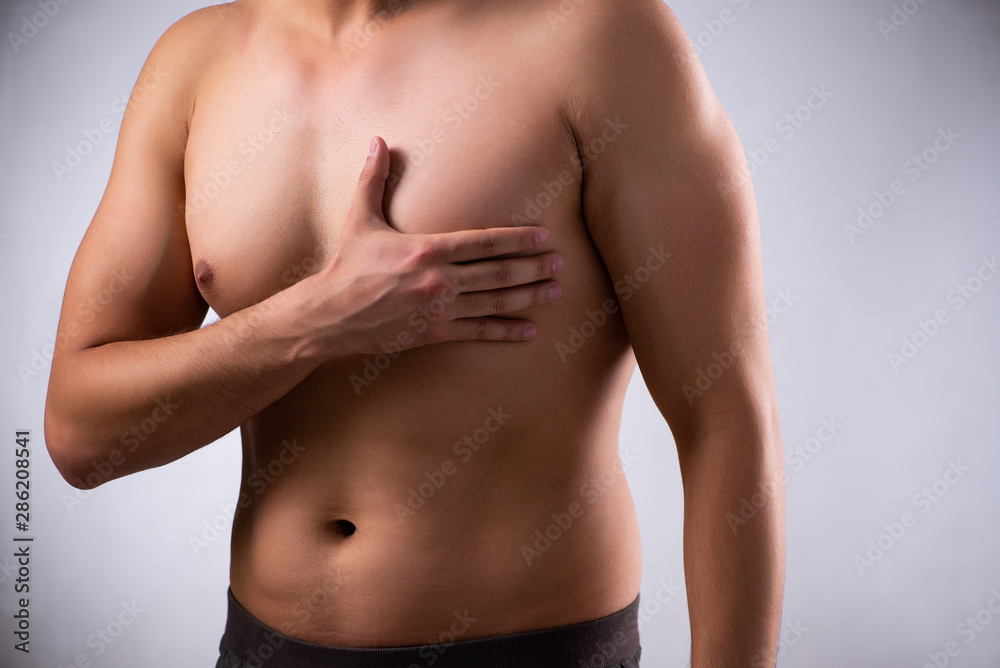 Fototapety, obrazy: Young man suffering from heart attack