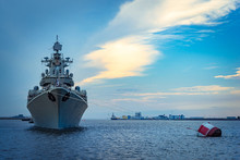 Missile Cruiser. Military Ship Against The Backdrop Of A Beautiful Sky. Naval Forces. Protection Of Maritime Borders. The Destroyer Guards The Strait At Sea.