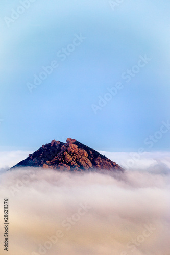 Mountain Peak Above the Fog and Cloud
