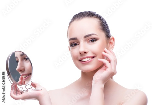 Woman in beauty concept applying make up using cosmetics Canvas Print