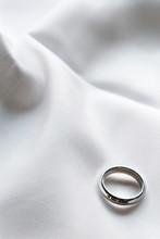 Wedding Ring On Fabric Backgro...