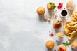 Fresh muffins or cupcakes with papercups. Top view, copy space. Grey concrete background. Sweet baked pastry
