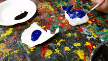A Student Is Painting A Public Domain Of Whale Sculpture For Decoration. Arts And Handworks Concept Image.