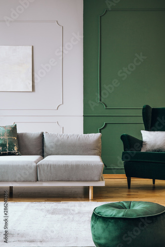 Stylish living room interior with trendy sofa with pillows, real photo