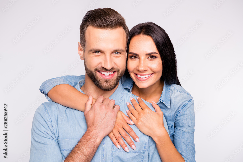 Fototapety, obrazy: Close up photo of sweet lady and guy with toothy smile cuddling wearing denim jeans shirt isolated over white background